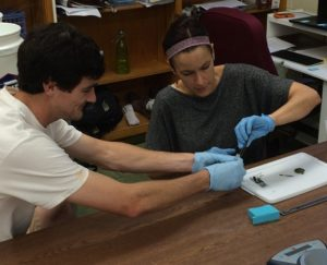 Davis Carter '15 and Dr. Goodman working with a specimen