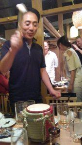 Oshima sensei opening a sake barrel.